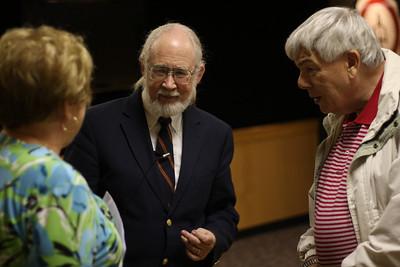 "Dr. Webb giving a seminar on ""deep throat""."