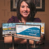 Tribune-Star/Joseph C. Garza<br /> Just a few of her projects: Rachel Leslie, senior vice president of the Terre Haute Chamber of Commerce, poses next to miniature billboards representing just a few of her numerous projects at the chamber. Leslie was recognized in the latest issue of Chamber Executive as a rising star in the profession.