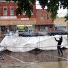 Set-up: A vendor erects a tent on the square in Rockville during a steady rain Thursday. The annual Covered Bridge Festival starts Friday.