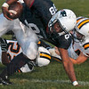 Tribune-Star file photo/Joseph C. Garza<br /> Still going: Terre Haute North's Aaron Allen keeps his momentum after two Castle defenders tried to tackle him while he made a catch during the Patriots' game against the Knights Friday, Aug. 21 at North.