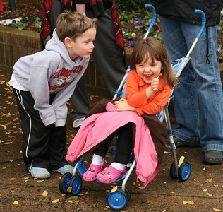 A child of the Boiling Springs community teases his sister as they wait with their parents for the start of the Homecoming day parade on Saturday.