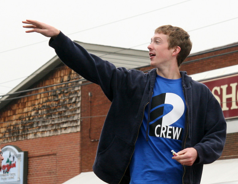 A sophomore tosses candy to the crowd from the sophomore class float during the Homecoming day parade on Saturday.