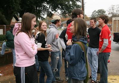 Students and alumni await the start of the Homecoming day parade on Saturday.