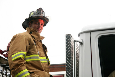 A firefighter of the Boiling Springs Fire Department smiles for the camera during the Homecoming day parade that featured the Army ROTC color guard, the GWU Marching Bulldogs, candidates for Homecoming queen, floats from each class and floats from several clubs.