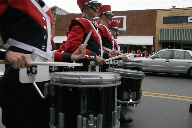 The snare line of the GWU Marching Bulldogs drums to the Fight Song during the Homecoming day parade on Saturday.