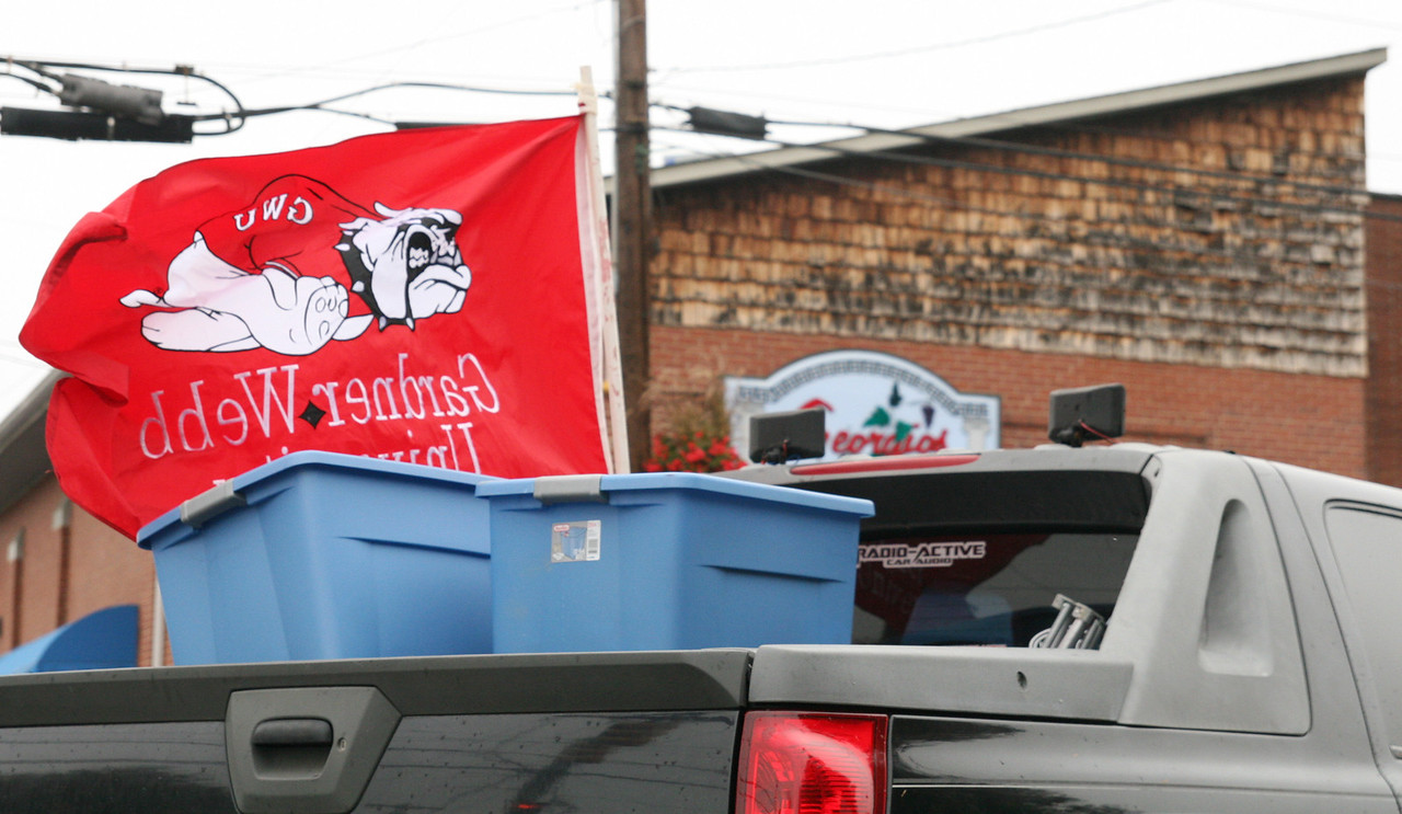 A truck sports the Gardner-Webb Runnin' Bulldogs flag just prior to the Homecoming day parade, featuring the Army ROTC color guard, the GWU Marching Bulldogs, candidates for Homecoming queen, floats from each class and floats from several clubs.  Boiling Springs Fire and Police Departments also made an appearance.