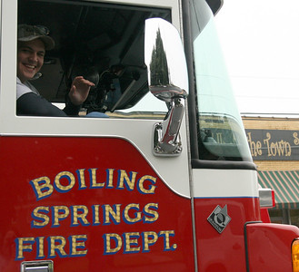 A member of the Boiling Springs Fire Department waves for the camera during the Homecoming day parade on Saturday.