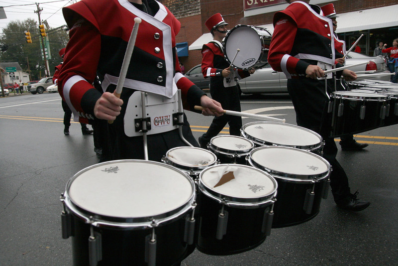 The Marching Bulldogs' tenor line plays the Fight Song during the Homecoming day parade on Saturday.