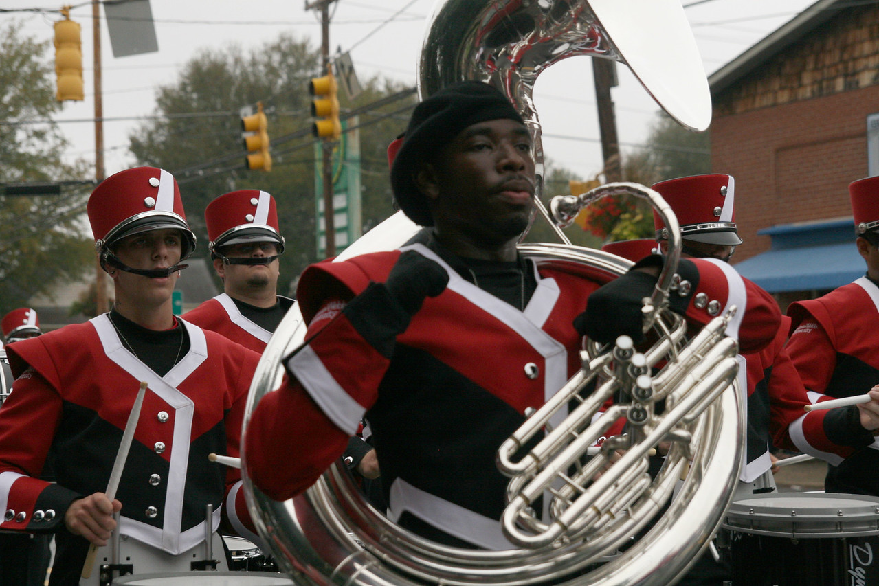 A sousaphone player of the Marching Bulldogs chants to the Fight Song during the Homecoming day parade on Saturday.