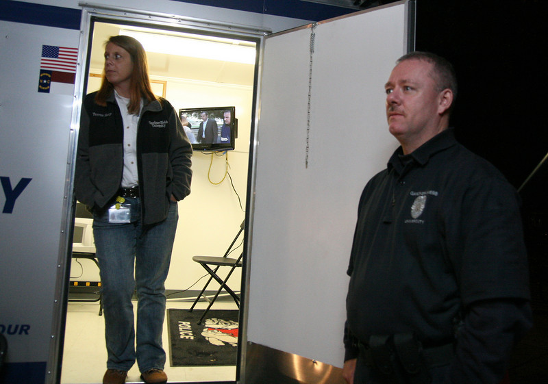 (L-R) Teresa Harp, UP office manager, and Officer Barry Lane are ready to serve from their mobile unit set up on the quad about midnight Friday night during Homecoming weekend.