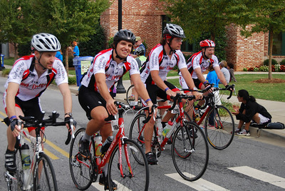 The GWU MS Bike Team rides through the finish line together.