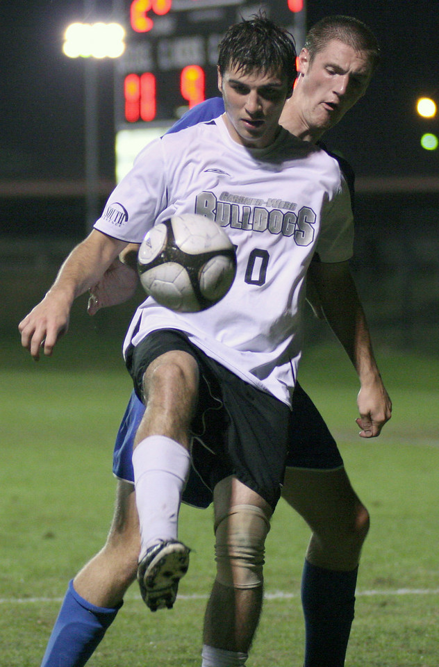 Forward Gerard Hefferon blocks an opponent in the mens' soccer 2-1 victory over UNC Asheville Wednesday night.