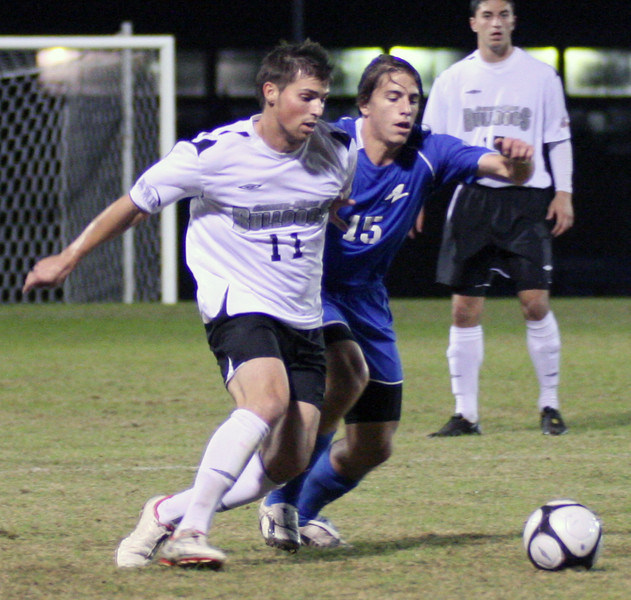 Midfielder Eric Asanin-Miroux (11) battles an opponent in the mens' soccer 2-1 victory over UNA Asheville Wednesday night.