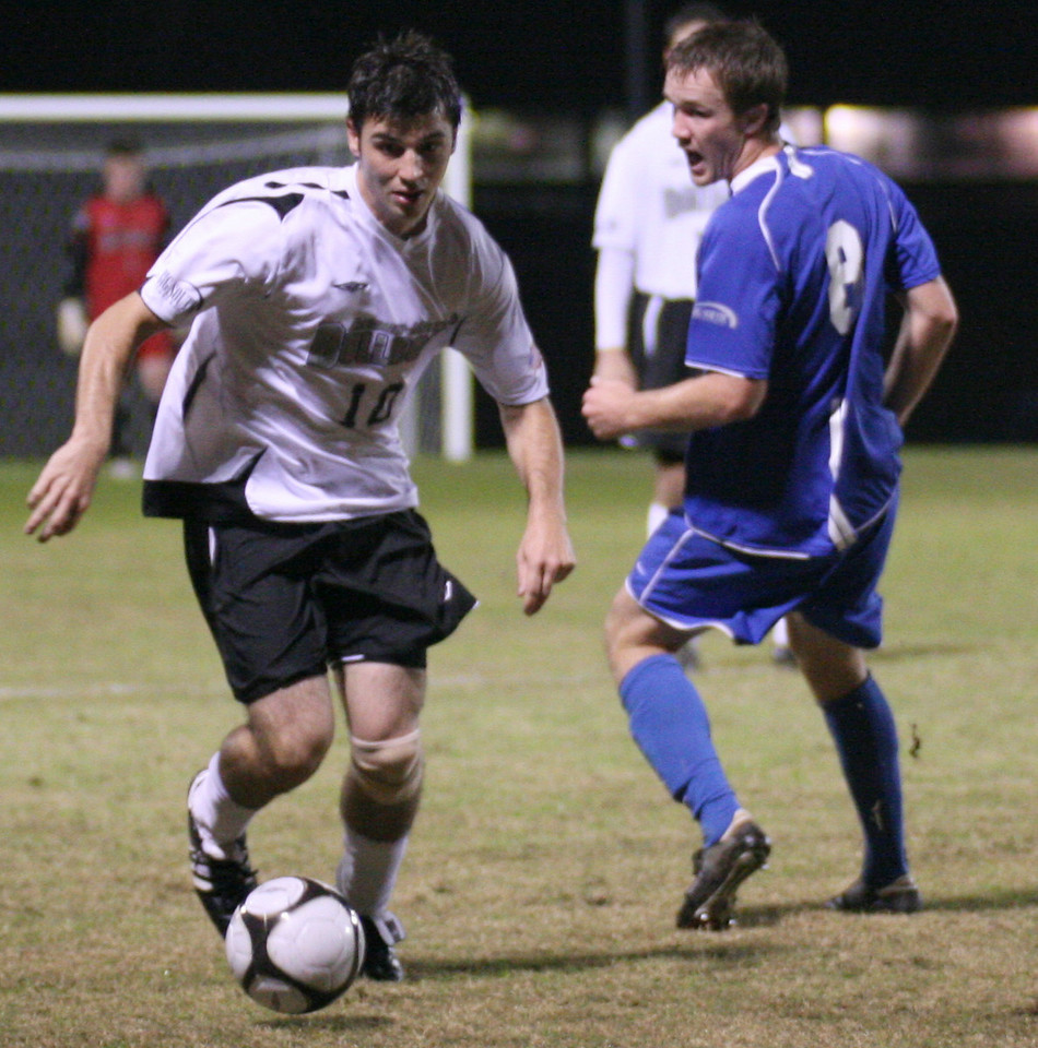 Forward Gerard Hefferon (10) steals the ball from an opponent.  The men's soccer team sealed a victory over UNC Asheville 2-1 Wednesday night.