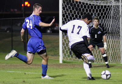 Forward Taylor Jordan (17) makes a shot on goal.  The men's soccer team sealed a victory over UNC Asheville 2-1 Wednesday night.