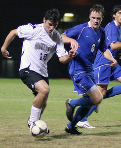 Forward Gerard Hefferon (10) takes the ball downfield in the second half.  The men's soccer team sealed a victory over UNC Asheville 2-1 Wednesday night.