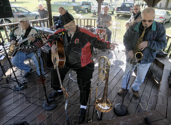 Playin' my song: Members of Big Daddy's Band of Gold perform at Old Fashioned Days in Collett Park Sunday.