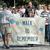 Remember: A large group of walkers participate in the Walk to Remember event at Deming Park Sunday afternoon.