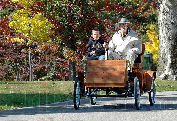Replica mobile: Twelve-year-old Beau Sciotto gets a ride in Richard Maher's replica vintage 1098 automobile through Collett Park Sunday afternoon.