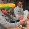 Tribune-Star/Joseph C. Garza<br /> Ear today, gone tomorrow?: Volunteer Rance Fuqua weighs a package of Homestyle Pancake Mix as he helps Dustin Rowe package the ground mix at the Bridgeton Mill Sunday during the last day of the Covered Bridge Festival.