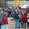Tribune-Star/Joseph C. Garza<br /> Last day nibbles: Covered Bridge Festival attendees fill a Bridgeton street which is lined with food booths during the festival's last day Sunday.
