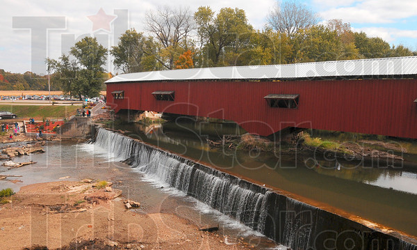 Tribune-Star/Joseph C. Garza<br /> A beautiful last day: Attendees of the Covered Bridge Festival in Bridgeton enjoy the scenery during the last day of the annual event Sunday.