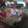 Tribune-Star/Joseph C. Garza<br /> Welcome to Parke County: Cathy Harkrider, executive secretary of Parke County Incorporated, chats with Covered Bridge Festival visitors, Jacque White of Spring Lake, Mich., and Karen and Robert Johnson of Plainfield Sunday in Rockville.
