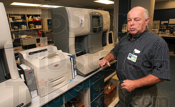 Tribune-Star/Joseph C. Garza<br /> Made the move in 1979: Regional Hospital IT Director Michael Kuckewich discusses the significant advances in technology that have taken place since he was a lab technician back in the late 1970s at St. Anthony's Hospital to today Sunday in the hospital's lab.