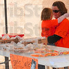 Tribune-Star/Joseph C. Garza<br /> Bake sale buddies: Karley Lewis, 6,  hugs her aunt, Ryan Greve, as they sell baked goods to raise funds for the Buddy Walk Sunday at the IGA in West Terre Haute.