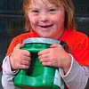 Tribune-Star/Joseph C. Garza<br /> Full of energy: Occasionally, Karley Lewis, 6, had to help hold donation collection jugs while at the West Terre Haute IGA Sunday.