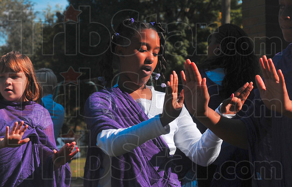 Tribune-Star/Joseph C. Garza<br /> Praise performance: Jadyn Johnson, a member of the New Birth Dance Ministry, performs with fellow members during the New Birth Community Church' church dedication Sunday at Gilbert Park.