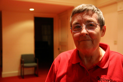 Plant Operations worker Melinda Condrey, of Grover, NC, smiles for the camera in Dover Chapel late Monday night.  She cleans both the Chapel and Hamrick Hall each evening.