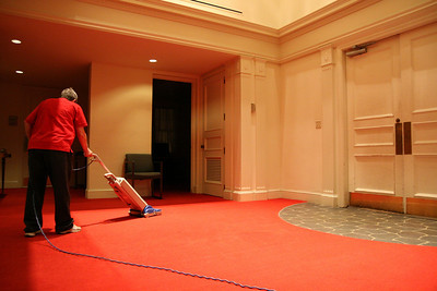 Plant Operations worker Melinda Condrey, of Grover, NC, vacuums in Dover Chapel late Monday night.  She cleans both the Chapel and Hamrick Hall each evening.