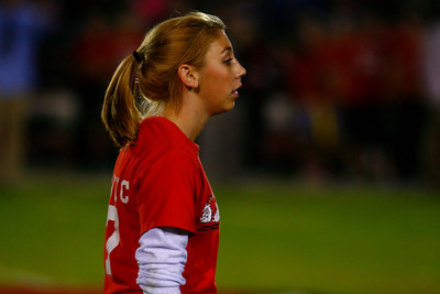 A favorite activity for students during Homecoming weekend is Powder Puff Football, played by girls.  Here Taylor Bowen Prepares for the next play.