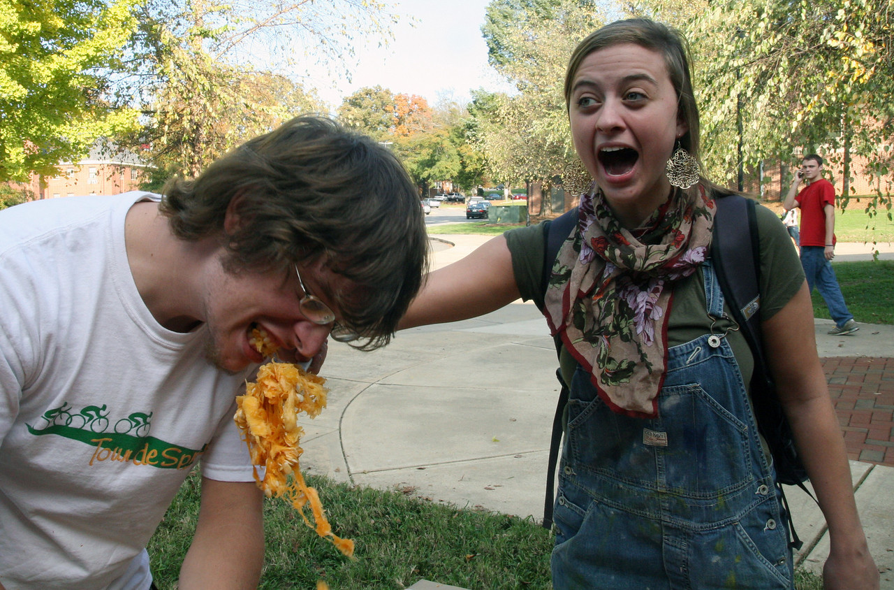 Katie Grace Kibler (sophomore) is shocked as Justus Hawks (senior) actually takes a bite of some pumpkin guts.  Several students enjoy a pumpkin carving contest sponsored by SGA Thursday afternoon as part of the 2009 Homecoming festivities.