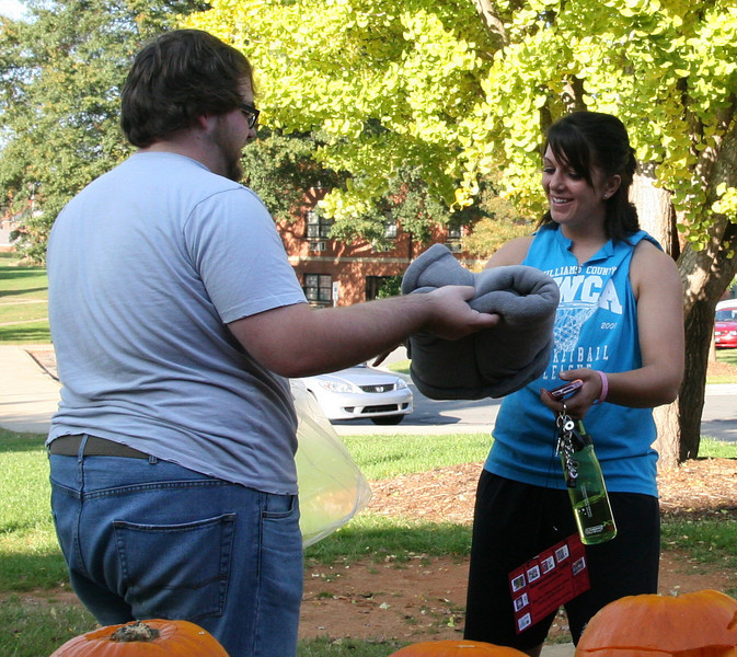Brianna Thompson (senior) accepts the first place prize for Best All Around Pumpkin during the pumpkin carving contest sponsored by SGA Thursday afternoon as part of the 2009 Homecoming festivities.