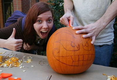 Ruthie Moore (sophomore) poses with a pumpkin designed by Tommy Grassman.  Several students enjoyed a pumpkin carving contest sponsored by SGA Thursday afternoon as part of the 2009 Homecoming festivities.