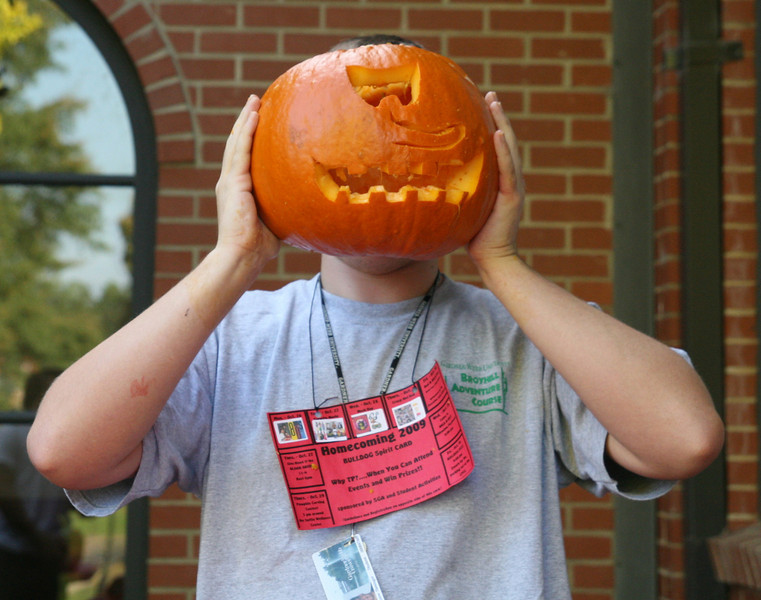 """Andrew Slesinger (freshman) poses with his cyclops pumpkin """"Gourd"""" during the pumpkin carving contest sponsored by SGA Thursday afternoon as part of the 2009 Homecoming festivities."""