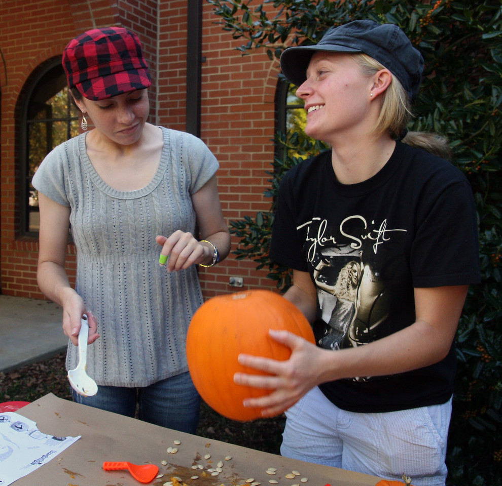 Savanna Yount (sophomore, left) and Brianna Clemmons (freshman) try to decide on a design for their pumpkin during the pumpkin carving contest sponsored by SGA Thursday afternoon as part of the 2009 Homecoming festivities.