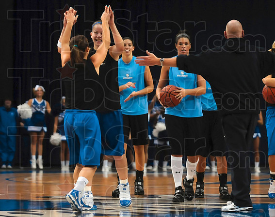Tribune-Star/Joseph C. Garza<br /> Three-point threats: Indiana State senior Kelsey Luna is congratulated by teammate Chelsey Buher after Luna won a three-point shooting contest in which Buher and she were the finalists Friday at Hulman Center.