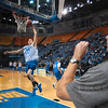 Tribune-Star/Joseph C. Garza<br /> Driven to succeed: Indiana State basketball coach Kevin McKenna instructs his players as incoming junior Jake Kelly drives to the basket during the team's open practice Friday at Hulman Center.