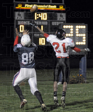 Touchdown: North's #88, Aaron Allen makes an over-the-shoulder catch for a touchdown during first quarter action Friday night against Indy North Central.
