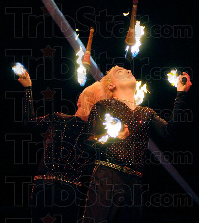Firemen: A juggling act performs at the Shrine Circus Friday evening at Fairbanks Park. The circus continues through the weekend.