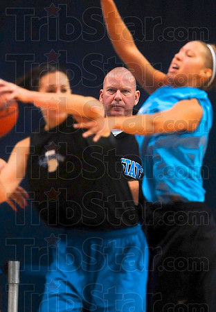 Tribune-Star/Joseph C. Garza<br /> Close watch: Indiana State head coach Jim Wiedie keeps an eye on the action during his team's open practice Friday at Hulman Center.