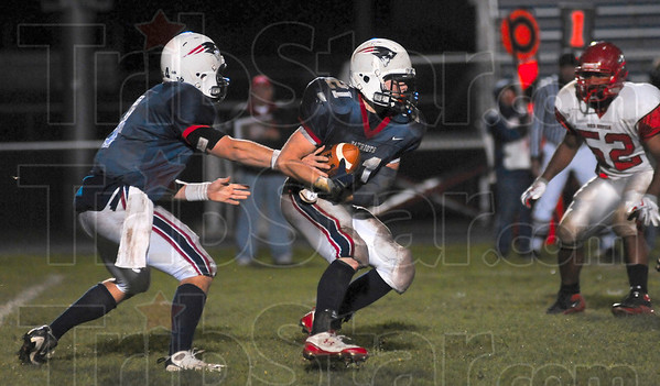 Tribune-Star/Joseph C. Garza<br /> Go fourth and score: Terre Haute North's Chris O'Leary hands off the ball to teammate Daniel Gabbard during the Patriots' sectional game against Pike Friday at North.