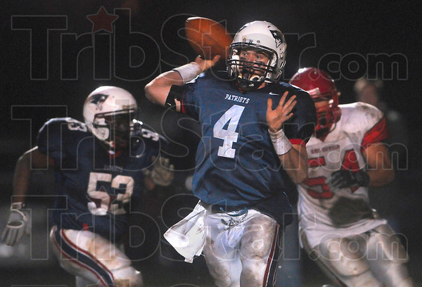 Tribune-Star/Joseph C. Garza<br /> Trying to get something started: Terre Haute North quarterback Chris O'Leary finds an teammate Aaron Allen open during the fourth quarter of the Patriots' game against Pike Friday at North.