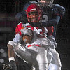 Tribune-Star/Joseph C. Garza<br /> Too much going their way: Pike's Jeffrey Harmon makes a catch under the tight defense of Terre Haute North's Dillon Hare during the Patriots' sectional game against the Red Devils Friday at North.