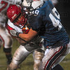 Tribune-Star/Joseph C. Garza<br /> Slow down their run: Terre Haute North's Lee Davis stops Pike running back Cameron Crabtree in his tracks during the Patriots' sectional game against the Red Devils Friday at North.