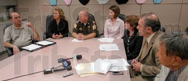 Flu shot: Vigo Co. Health department, School Corp. and Sheriff's department personnel discus the program to vaccinate all students at a press conference Friday afternoon. From left, Det. Frank Shahadey, Joni Foulkes, Deputy Chief Greg Ewing, Megan Bland, Travella Myers, Ray Azar and Dr. Enrico Garcia.