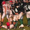 Tribune-Star/Joseph C. Garza<br /> Let that be a lesson: West Vigo's Ryan Roach (44) is congratulated by teammates after he sacked Southmont quarterback Logan Petry, center, on ground, during the Vikings' sectional loss Friday at West Vigo.